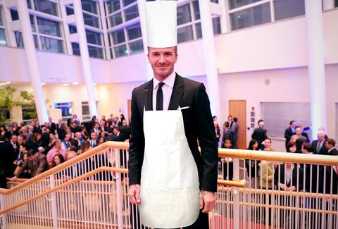 David Beckham in chef's toque and apron