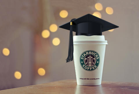 Starbucks cup with graduation cap
