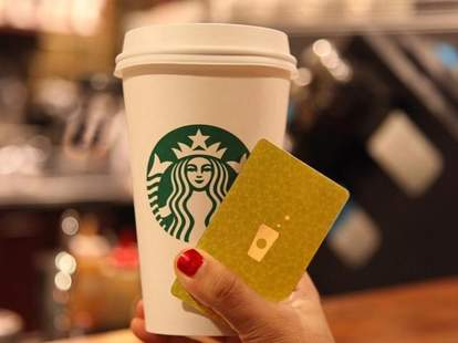 Starbucks drink with gold card