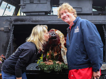 Brad and Brooke with the pig