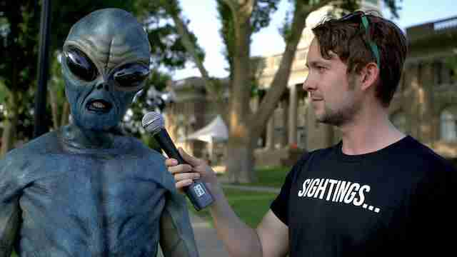 man interviewing alien