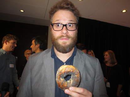 Seth Rogen eats a bagel