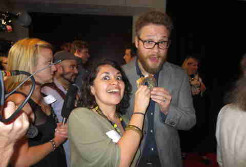 Anita Flores and Seth Rogen with a bagel
