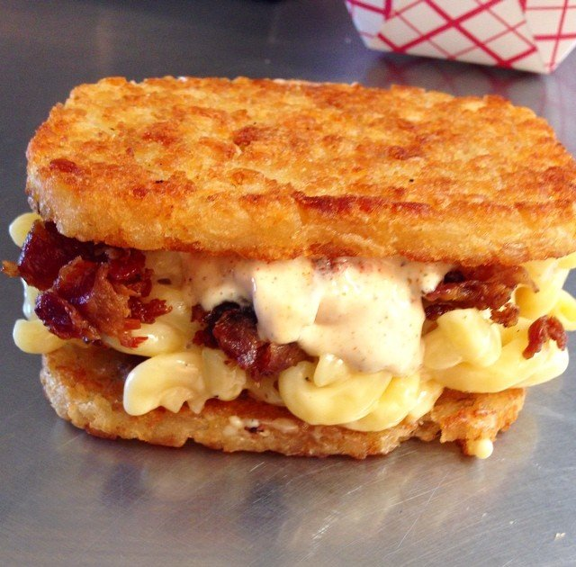 This breakfast sandwich has hash browns on the outside, bacon mac inside