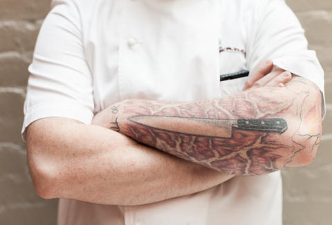 knife tattoo on chef