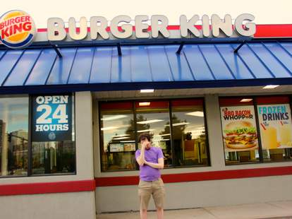 sad man in front of Burger King