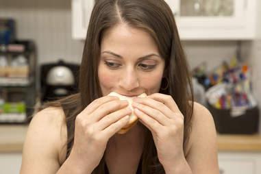 Eating a jerky sandwich