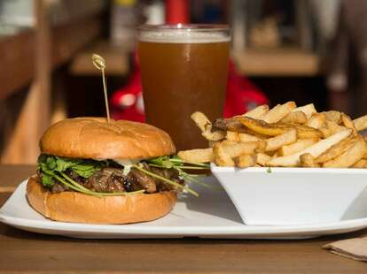 burger and fries and beer at uneeda burger in fremont seattle washington
