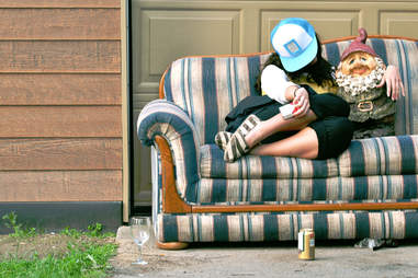 girl drinking on couch