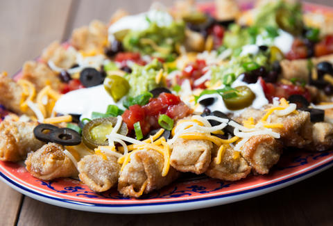 Chimichanga Nachos guarantee each bite has cheese, chiles, and ground beef. — Thrillist Recipes