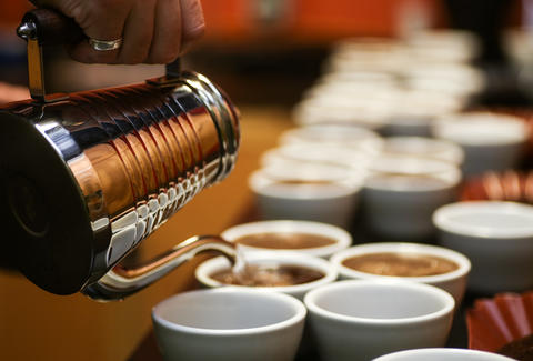 pouring cups of coffee