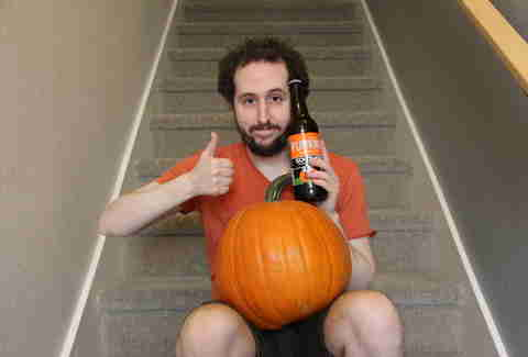guy with pumpkin beer