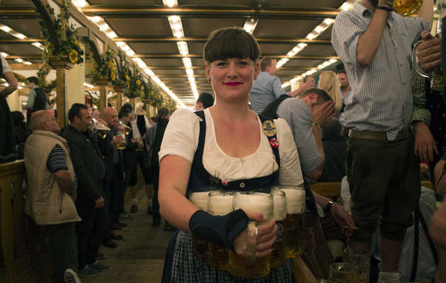 Tight dirndls, heavy beers, and grabby hands: The life of an Oktoberfest waitress