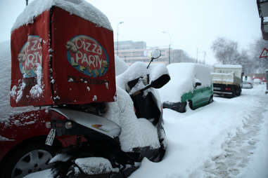 winter pizza delivery scooter