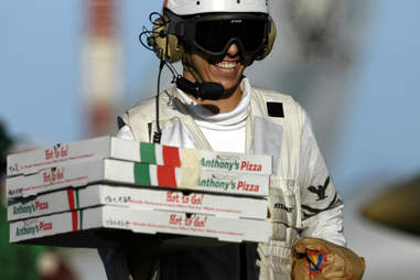 pizza delivery man smiling