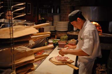 pizzaiolo in pizzeria kitchen