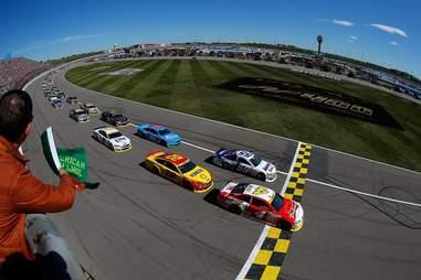 Race cars crossing finish line