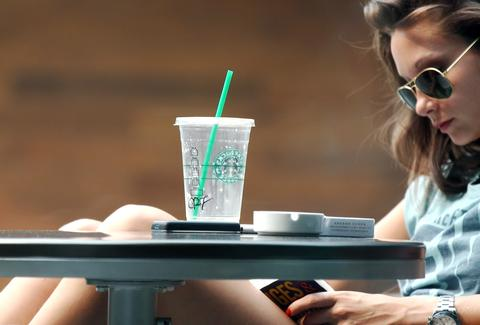 Girl reading at Starbucks