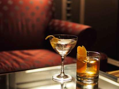 close up of martini and old fashioned cocktail at raines law room nyc bar