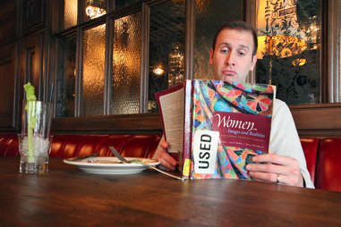 solo diner with book