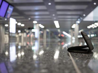 wallet on airport floor