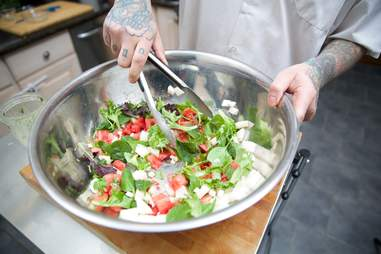 Watermelon salad being made