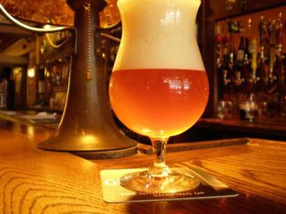 a full pint glass from the ginger man craft beer bar new york city