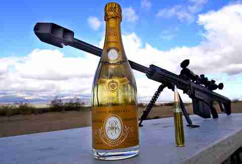 Bottle of Cristal and a .50 caliber sniper rifle