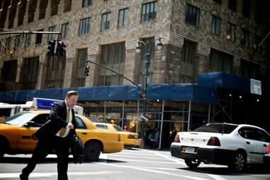 man walking in street in new york city