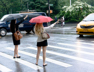 two women hailing a cab in new york city