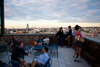 people at a roof top bar