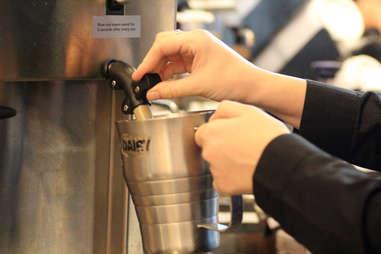 Starbucks steaming milk