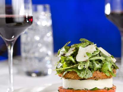 salad with lettuce and cheese glass of wine martoranos las vegas