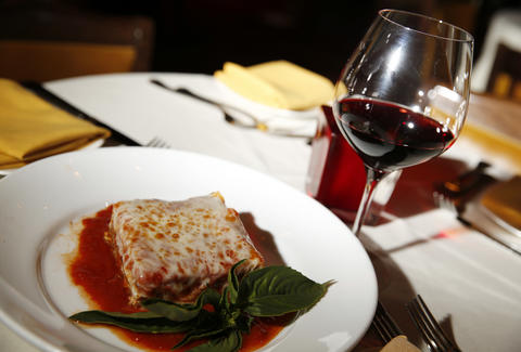 lasagna and a glass of red wine at ferraro's italian las vegas