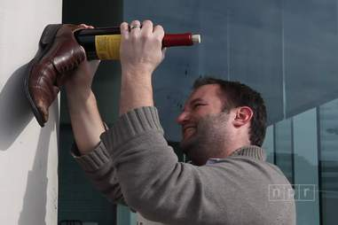 Opening wine with a shoe