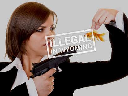 Lady pointing gun at fish