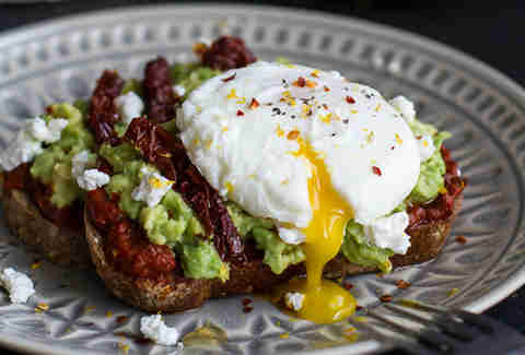 Harissa avocado toast with goat cheese and honey
