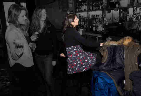 Woman taking up space at bar