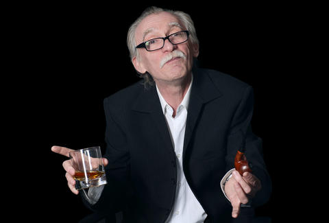 Old man with drink and pipe