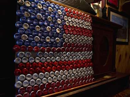 American flag made of beer bottle caps