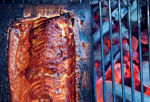 close up of meat on a grill Shack in the Back BBQ
