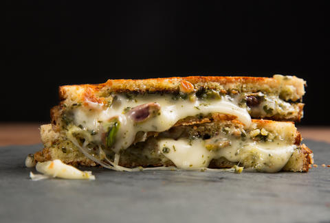 Taleggio, pesto, and pistachio grilled cheese — Thrillist Recipes