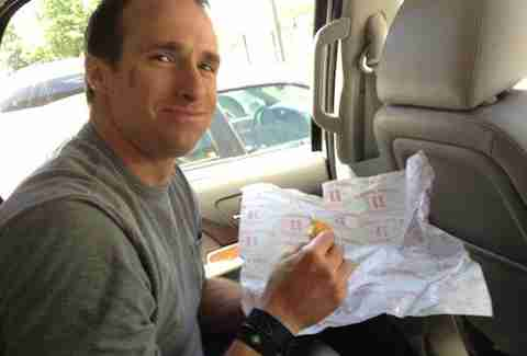 Drew Brees with Jimmy John's sandwich