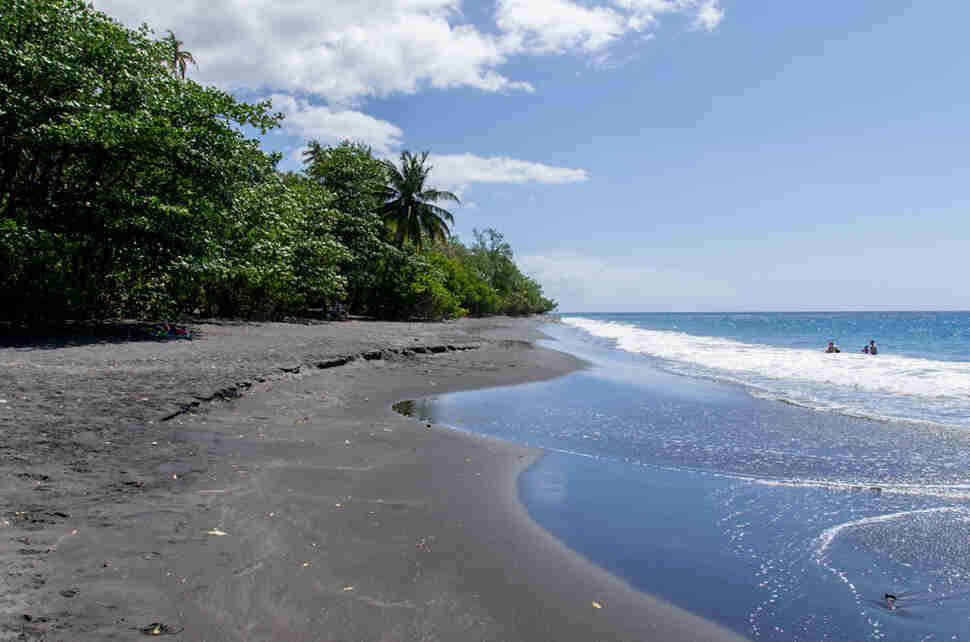 Stunning black sand beaches you have to visit thrillist for Black sand beach caribbean