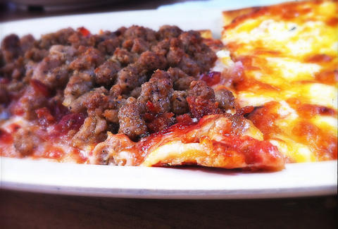 meat pizza thin slice cheese slice memphis pizza cafe thrillist
