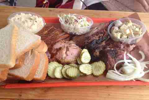 Tray of BBQ, pickles, fresh bread, and cole slaw at Little Miss BBQ