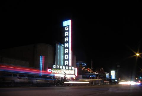 outside the granada theater at night in dallas