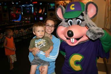 Chuck E. Cheese mascot with kid