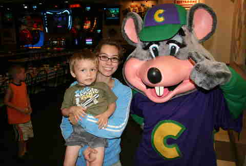 Chuck E. Cheese mascot with kid