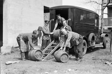 Men loading kegs onto truck